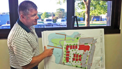 Developer Glen Catt discusses his redesigned One Water Street project Tuesday with Boyne City commissioners.
