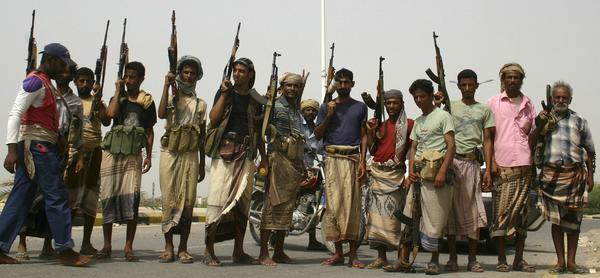 Pro-army tribesmen pose for a group photo on a street in the southern Yemeni city of Jaar June 13, 2012. Yemen on Wednesday pressed ahead with a U.S.-backed offensive to drive al Qaeda-linked insurgents from the country's south.