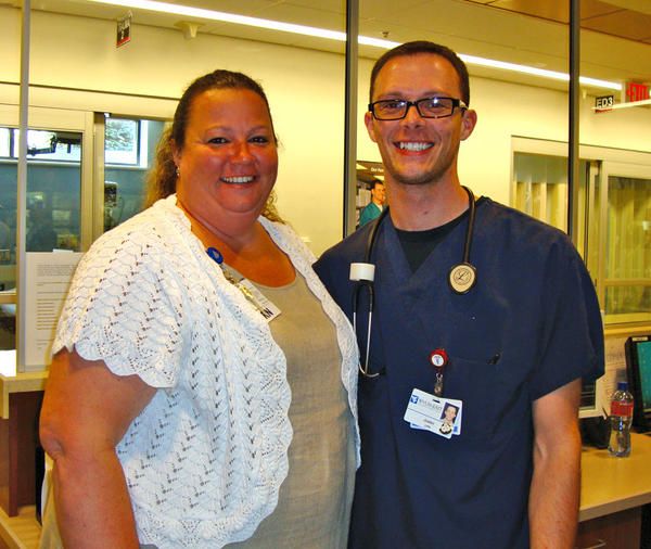 Jefferson Memorial Hospita's Justin Campbell, right, is pictured with Denise Carter, nurse manager of the emergency department and special-care unit, after receiving the DAISY Award For Extraordinary Nurses at a recent ceremony at the hospital.