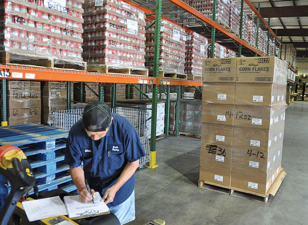 Mitch Barnes fills senior commodity food program orders in the warehouse in the Winchester-Clark County Industrial Park.