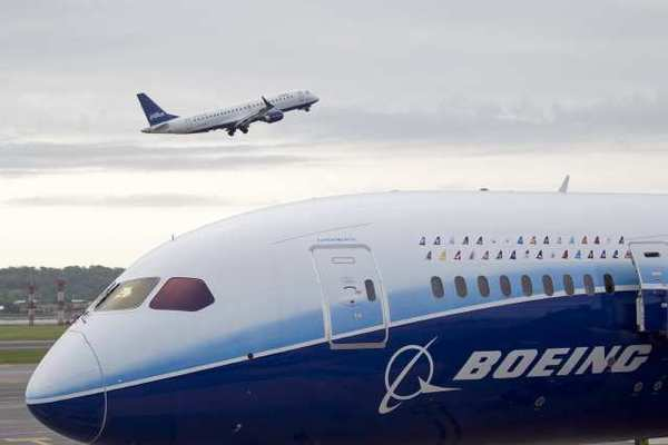 A JetBlue Airways Corp. airplane takes off past a Boeing Co. 787 Dreamliner. JetBlue topped a customer satisfaction survey for the seventh year in a row.