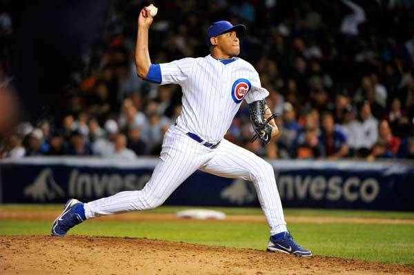 Chicago Cubs relief pitcher Carlos Marmol (49) delivers a pitch against the Detroit Tigers during the eighth inning at Wrigley Field.