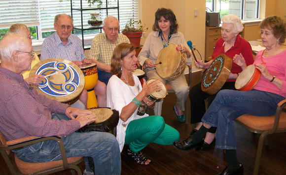 Residents at Plymouth Place in La Grange Park have several outlets for creativity. Above, a group participates in a drumming circle.