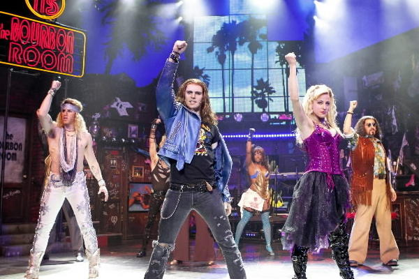 "Young rockers may never die, but they sure party heartier in a smaller theater. Phoenix Entertainment's non-Equity tour of ""Rock of Ages"" is staging a summer run at the 550-seat Broadway Playhouse. This campy celebration of the rockers of the 1980s (now also a movie starring Tom Cruise) comes close to replicating the experience on Broadway, which is, basically, the experience of laughing along with a cheesy book about a small-town girl and a wannabe rocker looking for love on the Sunset Strip and finding an excuse to trot out high-octane, amusingly out-of-context versions of ""Don't Stop Believin',"" ""Can't Fight This Feeling¿ and other masterworks of the era. -- Chris Jones<br><br><b>Through Aug. 5 in the Broadway Playhouse, 175 E. Chestnut St.; $70-$80 at 800-775-2000 or broadwayinchicago.com</b>"