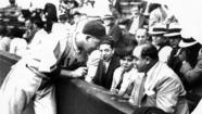 1931: Gabby Hartnett of the Cubs talks with Al Capone