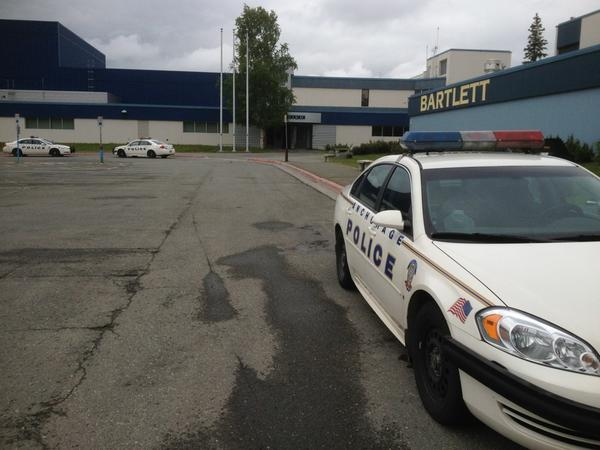 Police respond to bear cub inside Bartlett High.