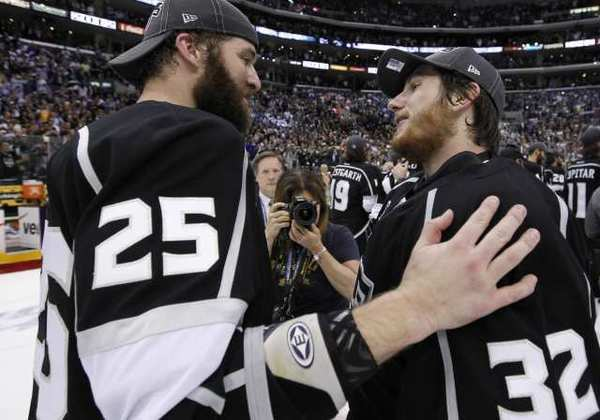 Dustin Penner, left, talks with teammate Jonathan Quick after the Kings won the Stanley Cup.