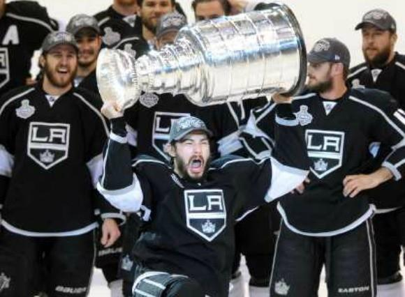 Drew Doughty celebrates with the Stanley Cup.