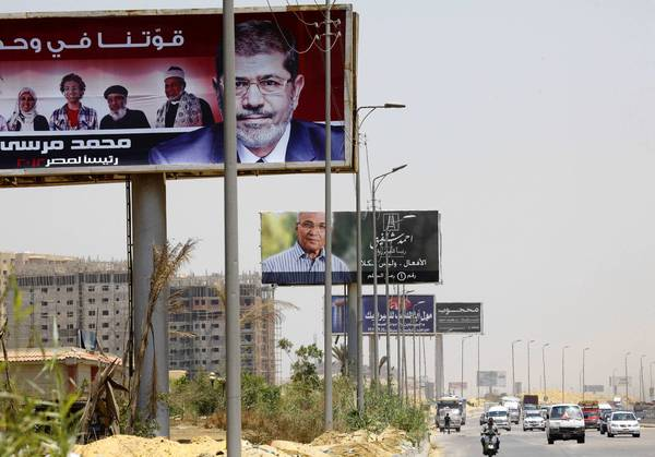 Billboards on a highway in Cairo show Egyptian presidential candidates Mohamed Morsi and Ahmed Shafik.