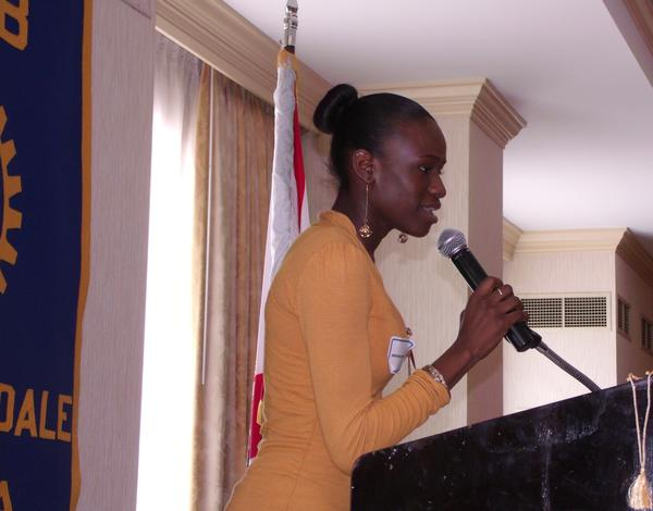 Nkenge Burnett, 17, says thank you to the Downtown Fort Lauderdale Rotary Club for presenting her with a $2,500 scholarship for Broward College starting in the fall. The Rotary Club passed the $2 million mark for scholarships with its most recent grants.