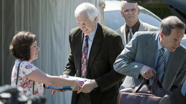 Jerry Sandusky helps load the car as he leaves after the third day of his trial at the Centre County Courthouse in Bellefonte on Wednesday. On the right is Joe Amendola.