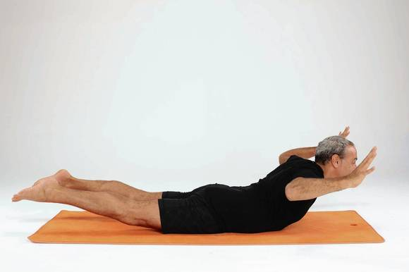 Bend your arms to the side with your elbows at shoulder height, palms flat on the floor.