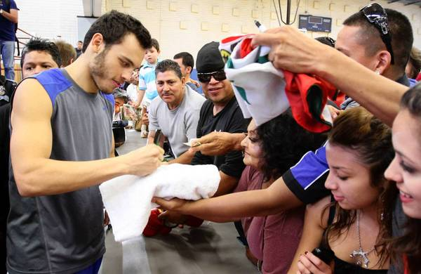 Boxer Julio Cesar Chavez Jr. meets fans in El Paso. He will defend his title against Irish challenger Andy Lee on Saturday at the Sun Bowl stadium, where alcohol will be banned during the fight.