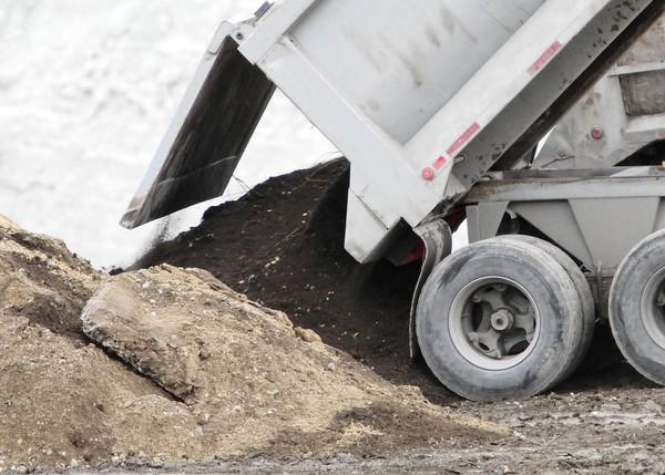 The Illinois Pollution Control Board's proposed new rules for waste dumping would not require quarries to test groundwater.