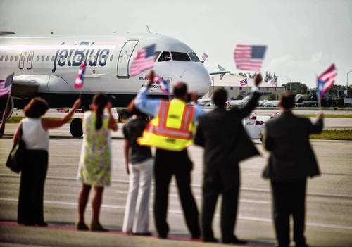 A JetBlue plane taxis towards the runway. JetBlue ranked highest in J.D. Power and Associates 2012 customer satisfaction index.