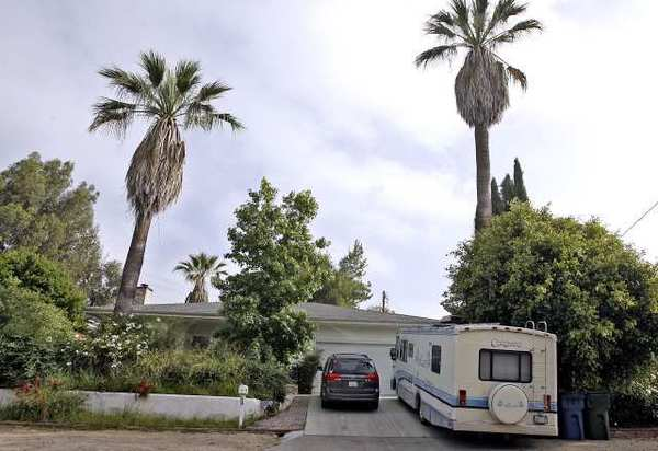 A recreational vehicle is parked at 1425 Curran St. in La Canada Flintridge. The city is considering a measure to regulate where residents can park their RVs, trailers and boats.