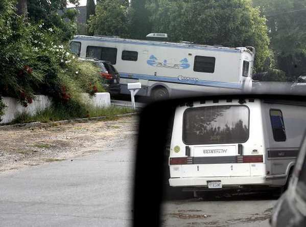 A recreational vehicle parked at 1425 Curran St. is seen in the background and another one parked at a home at the corner of Indiana and Curran is seen in the rear-view mirror in La Canada Flintridge.