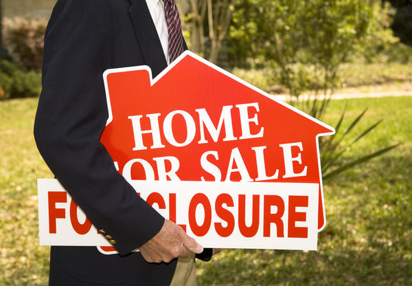 Wells Fargo, JPMorgan Chase and Citigroup nearly stopped their sales of homes in foreclosure after regulators revised their guidance on treatment of troubled borrowers.