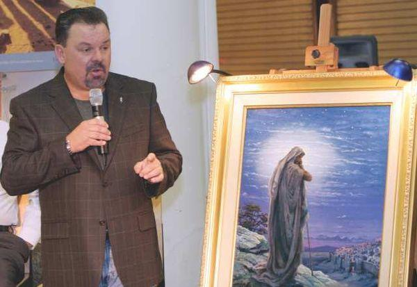 "Thomas Kinkade, with his painting ""Prayer for Peace,"" in 2006. He died in April at age 54."