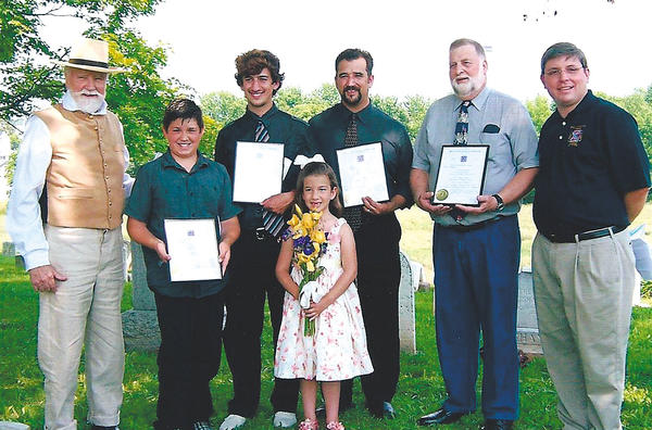 The Battle of Sharpsburg Camp 1582, Sons of Confederate Veterans, swore in three generations of Sprechers on May 26 at the grave dedication ceremony of their ancestor in Clear Spring. Pictured, from left, are camp Chaplain Toby Law, Cole, Clay, Carrie, Tyler and Forrest Sprecher, and Camp Cmdr. Michael Wasiljov.