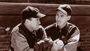 1938: Ted Williams, right, and Manager Joe Cronin