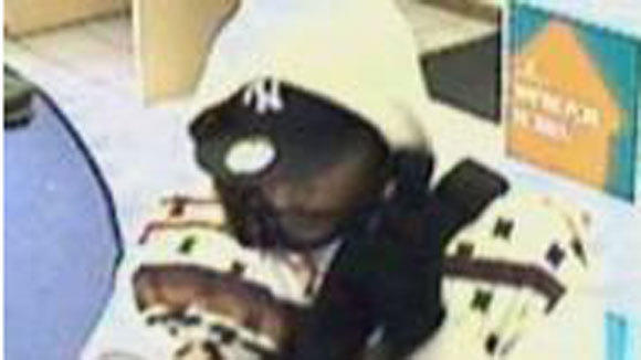 Armed man robs Charter One Bank