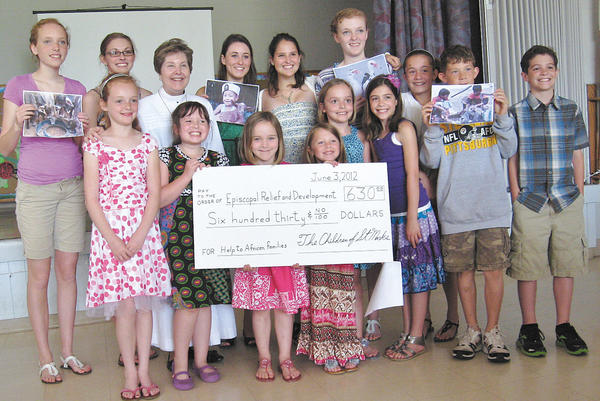 The Sunday school children and adults of St. Mark's Episcopal Church in Lappans collected $650 during Lent for the Gifts for Life program. Front row, from left, Morgan Groesbeck, Alison Parks, Julia Matthews, Taylor Massey, Maggie Matthews, Phoebe Meehan, Olivia Whitt, Colin Whitt and Beau Meehan. Back, row, Hayley Groesbeck, Caroline Fraser, the Rev. Anne Weatherholt, Annie Beachley, Elie Nogle and Devon Groesbeck.