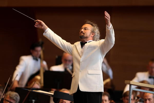 Carlos Kalmar leads the Grant Park Orchestra on opening night of the Grant Park Music Festival in Millennium Park's Pritzker Pavilion.