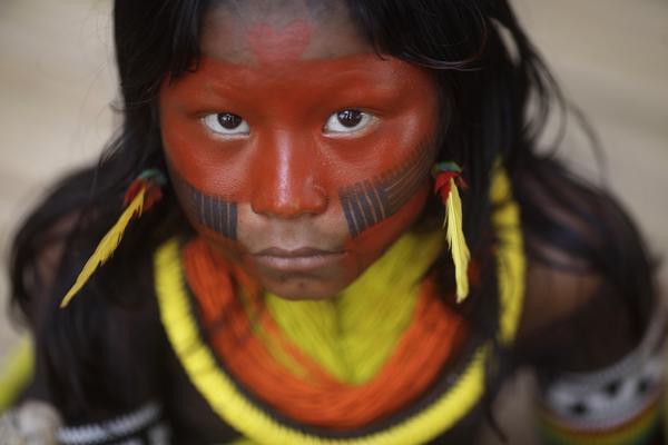 "An indigenous child from Kayapo tribe attends first indigenous assembly for the ""Rio +20"" Conference at Kari-Oca village in Rio de Janeiro June 14, 2012. Indigenous people from around the world are visiting the village for the ""Rio +20"" United Nations Conference on Sustainable Development."