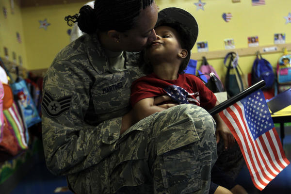 After six months in Kuwait, U.S. Air Force's Tonya Martinez reunites with her 3-year-old son Justin Abraham at Penny Lane School in Oak Lawn today.