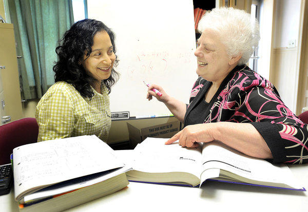 GED student Susana Trejo, left, of Hagerstown studies Algebra with Community Life Institute's Virginia Wilson, right, at Life House West Church on Salem Avenue in Hagerstown.