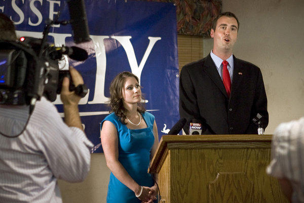Jesse Kelly, with wife Aubrey, delivers his concession speech on election night in Tucson on Tuesday.