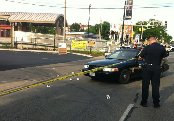 A police officer at a crime scene where eight shell casings were visible in the 4800 block of Oakton Street in Skokie.
