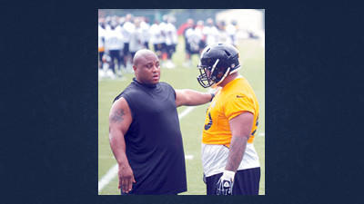 Pittsburgh Steelers nose tackle Casey Hampton, left, talks with rookie nose tackle Alameda Ta'amu during NFL football practice Tuesday in Pittsburgh.