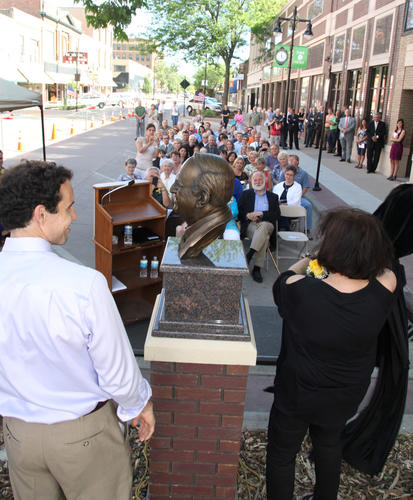 Benjamin Victor, left, and Marsha Luzier, right, unveiled the bust of Vi Stoia in a ceremony held Thursday evening at Third and South Main Street. Victor sculpted the bust and Luzier is Stoia's daughter. photo by john davis taken 6/14/2012