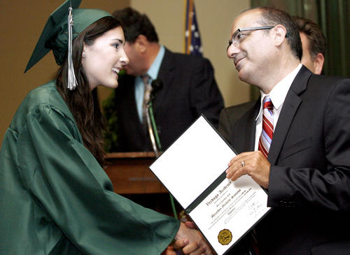 Mercedes Santana, 18 of Huntington Beach, left, gets her diploma from GUSD board member Greg Krikorian at the Verdugo Academy graduation at the First United Methodist Church Carlson Fellowship Hall in Glendale on Thursday, June 14, 2012.  Glendale Unified School District's Daily HS, Re-Connected Glendale and Verdugo Academy held the commencement exercises at the same time and location.