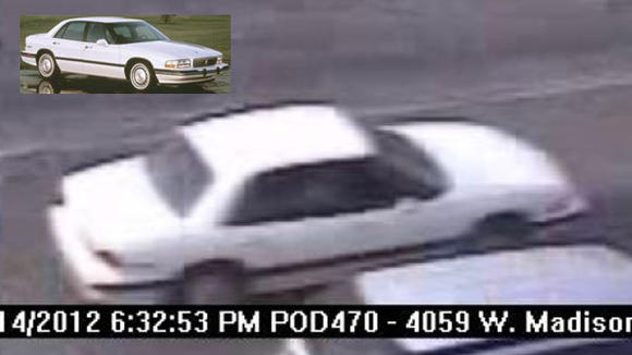 A photo of the car involved in the hit and run, taken from a city camera, and a car similar to the one involved (inset).