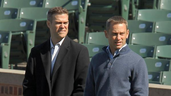 Cubs President Theo Epstein and GM Jed Hoyer watch batting practice in April at Wrigley Field. (Phil Velasquez/Tribune photo)