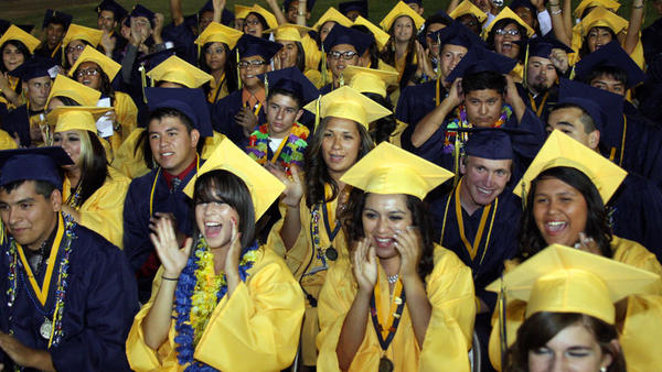 The Calipatria High School class of 2012 reacts as honor students speak during commencement exercises at Calipatria High School in Calipatria on Thursday.