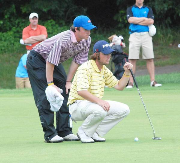 Petoskey native Joey Garber (right) studies the line of a putt with his brother and caddy, Tad, during the 100th Michigan Amateur at Boyne Highlands last year. Joey Garber finished runner-up in the tournament a year ago after winning it in 2010.