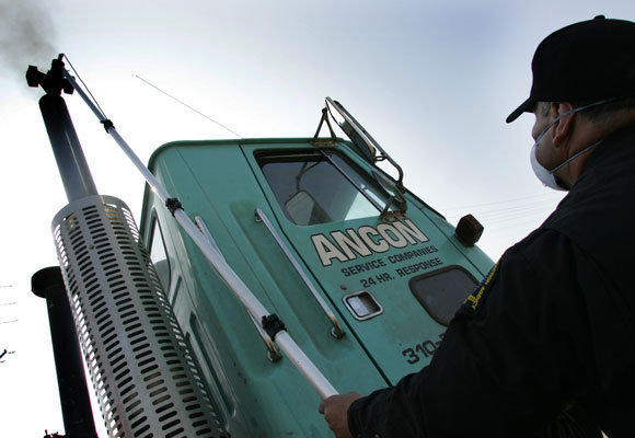 In this 2006 photo, California Air Resources Board inspector Paul Leon prepares to test the emissions of a diesel truck. This week the World Health Organization classified diesel exhaust as a carcinogen, linking it to lung and other cancers.