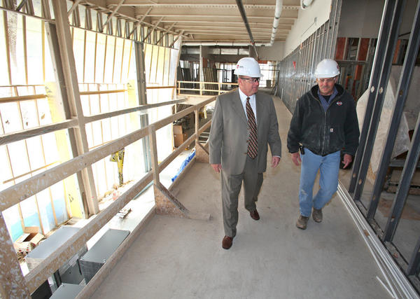 Gordon Larson, newly named chief executive officer of the Aberdeen Sanford Hospital, center, talks with Dave Hokel, project superintendent with Ball Construction, right, Wednesday as they tour the hospital being built near the current Sanford Clinic. photo by john davis taken 4/20/2011