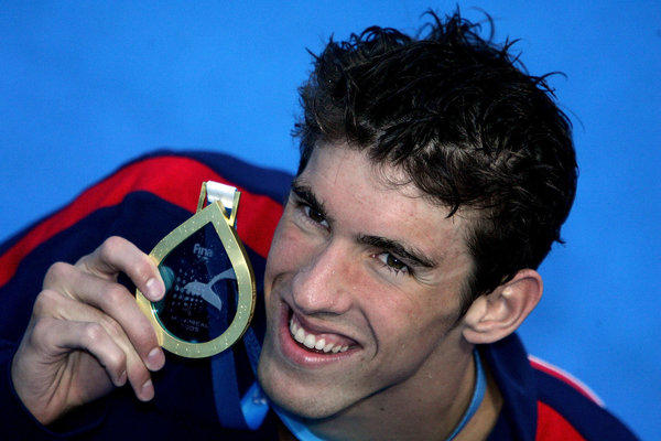 MONTREAL:  Michael Phelps of the United States smiles after winning the gold medal in the 200 meter Freestyle final during the XI FINA World Championships at the Parc Jean-Drapeau on July 26, 2005 in Montreal, Quebec, Canada.  (Photo by Alexander Hassenstein/Bongarts/Getty Images)