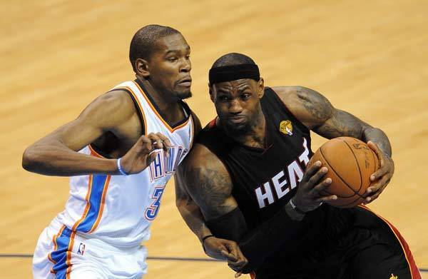 Miami Heat small forward LeBron James (6) drives against Oklahoma City Thunder small forward Kevin Durant (35) during the third quarter of game two in the 2012 NBA Finals at the Chesapeake Energy Arena.