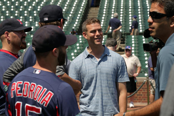 Theo Epstein (center) meets with members of his former team, the  Boston Red Sox.