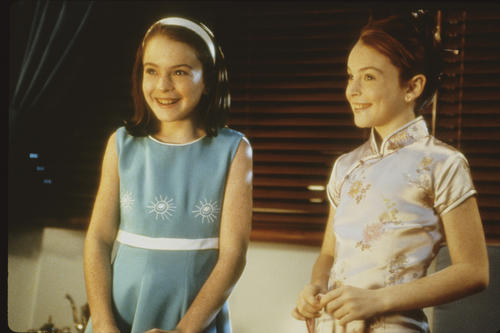 "Lindsay Lohan began her career at age 5, appearing in ads for Toys R Us and Calvin Klein Kids, among other brands. Her first acting role was on the sitcom ""Another World,"" but she first came to national attention when she played the dual role of Hallie Parker and Annie James in the 1998 remake of ""The Parent Trap."" Times film critic Kenneth Turan wrote at the time that the film ""can't be imagined without its 11-year-old redheaded star, Lindsay Lohan. Her bright spirit and impish smile make for an immensely likable young person we take to our hearts almost at once. Lohan's the soul of this film as much as Hayley Mills was of the original."""