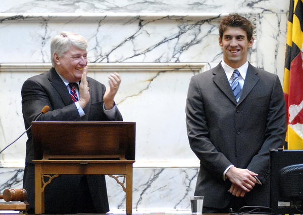 Staff photo by ALEX STAWINSKI  USA Olympic swimmer Michael Phelps of Towson, right, receives a round of applause from Maryland House of Delegates speaker Michael E. Busch and delegates during his visit to the General Assembly Thursday April 9, 2009. Phelps is a 14-time olympic gold medalist.