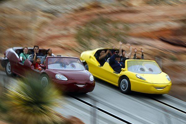 Riders experience the Radiator Springs Racers attraction at Disney California Adventure on the opening day of Cars Land.