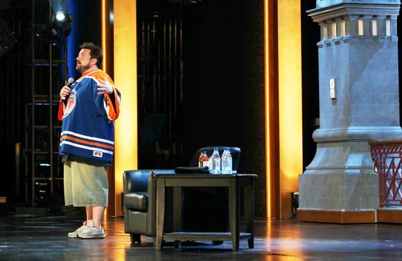 "Kevin Smith appears at the Chicago Theatre on Thursday as part of the TBS Just for Laughs Chicago comedy festival, in front of the set used for ""Conan"" tapings."
