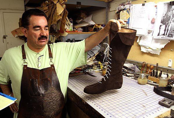 "Mauricio Osorio remakes a pair of boots from Errol Flynn's 1938 movie ""The Adventures of Robin Hood."""